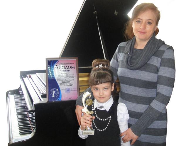 Растёт в Ветке пианистка
